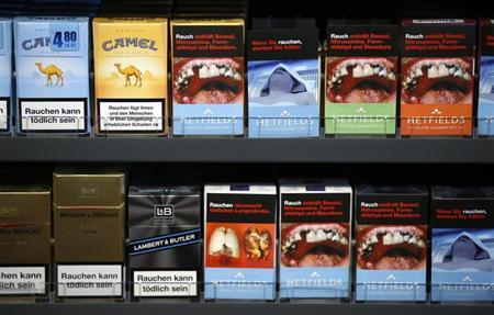 Cigarette boxes with an affixed, self-made cigarette label displaying graphic images (R) and those with the original label are pictured in the shop of tobacconist and kiosk owner Janine Schulzki in Berlin February 9, 2013. REUTERS/Fabrizio Bensch