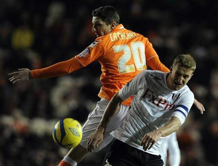 Blackpool's Craig Cathcart (L) challenges Fulham's Brede Hangeland during their FA Cup third round replay match in Blackpool, northern England January 15, 2013. REUTERS/Nigel Roddis