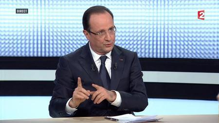 French President Francois Hollande, in this still image taken from video from France 2 television, appears during their prime time news broadcast at their studios in Paris, March 28, 2013. REUTERS/France 2 Television/Handout
