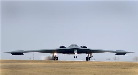 A U.S. Air Force B-2 Spirit bomber lands at Whiteman Air Force Base in Missouri in this handout photo taken March 20, 2011. The United States flew two Stealth bomber practice runs over South Korea on Thursday, in a second show of force to North Korea after a B52 bomber made a similar run earlier this week amid rising tensions on the Korean peninsula. REUTERS/Kenny Holston/U.S. Air Force photo/Handout