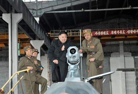 North Korean leader Kim Jong-un (2nd R) looks at the latest combat and technical equipments, made by unit 1501 of the Korean People's Army, during his visit to the unit March 24, 2013 in this picture released by the North's official KCNA news agency in Pyongyang March 25, 2013. REUTERS/KCNA