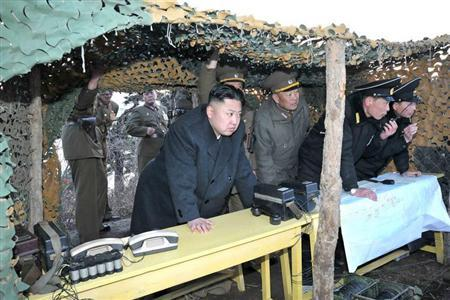 North Korean leader Kim Jong-Un (C) watches soldiers of the Korean People's Army (KPA) taking part in the landing and anti-landing drills of KPA Large Combined Units 324 and 287 and KPA Navy Combined Unit 597, in the eastern sector of the front and the east coastal area on March 25, 2013, in this picture released by the North's KCNA news agency in Pyongyang March 26, 2013. REUTERS/KCNA