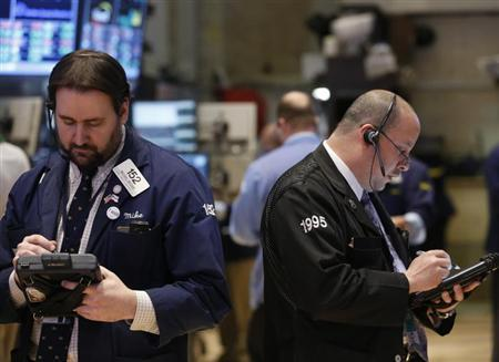 Traders work on the floor at the New York Stock Exchange, March 28, 2013. REUTERS/Brendan McDermid