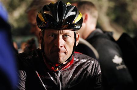 Seven-time Tour de France winner Lance Armstrong awaits the start of the 2010 Cape Argus Cycle Tour in Cape Town in this March 14, 2010 file photo. A spate of troubling stories in the first quarter of 2013 show an altogether darker and more disturbing side to the glamorous, multi-billion-dollar global sport industry. In January, American cyclist Armstrong admitted in a television interview that he had doped before each of his record seven Tour de France victories. His confession after years of denial followed the United States Anti-Doping Agency's (USADA) decision to strip him of the title and accuse him of being at the centre of the ''most sophisticated, professionalised and successful doping programme that sport has ever seen''. REUTERS/Mike Hutchings/Files