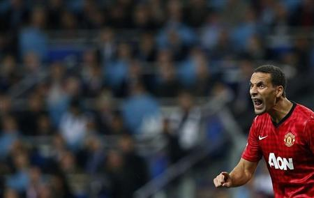 Manchester United's Rio Ferdinand celebrates his team's goal against Real Madrid during the Champions League soccer match at Santiago Bernabeu stadium in Madrid February 13, 2013. REUTERS/Susana Vera