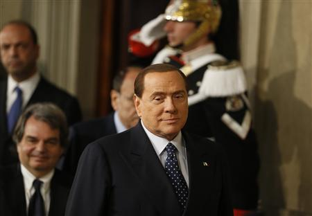 Italy's former Prime Minister Silvio Berlusconi arrives to attend a news conference following a meeting with Italian President Giorgio Napolitano at Quirinale palace in Rome March 29, 2013. REUTERS/Stefano Rellandini