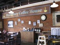 The Senoia Coffee and Cafe Shop displays the Woodbury Coffee House sign that was hung outside during the filming of the TV show The Walking Dead, in Senoia, Georgia, March 18, 2013. REUTERS/Colleen Jenkins