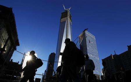 People walk by the World Trade Center site before ceremonies marking the 11th anniversary of the September 11, 2001 attacks on the World Trade Center at Ground Zero in New York September 11, 2012. REUTERS/Shannon Stapleton