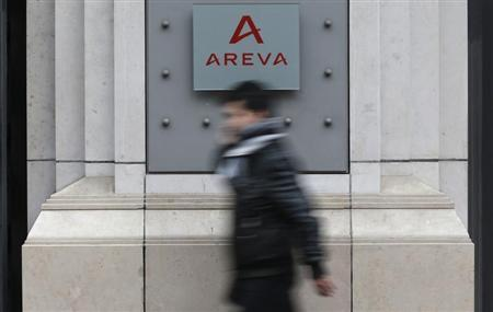 A man walks past French nuclear reactor maker Areva headquarters in Paris, February 28, 2013. REUTERS/Christian Hartmann
