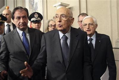 Italy president pledges to stay to deal with crisis