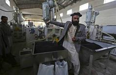 Najib Ullah Latify, the owner of factory High Standard Pipe explains about their factory in Kabul March 17, 2013. REUTERS/Omar Sobhani