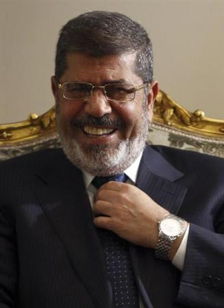 Egypt's President Mohamed Mursi laughs during his meeting with U.S. Secretary of State John Kerry (not pictured) at El-Thadiya presidential palace in Cairo March 3, 2013. REUTERS/Amr Abdallah Dalsh