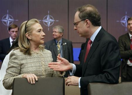 U.S. Secretary of State Hillary Clinton (L) talks to NATO Deputy Secretary General Alexander Vershbow before a Foreign Ministers meeting with Bosnia-Herzegovina, Georgia, Montenegro and Macedonia at the NATO Summit in Chicago, May 21, 2012. REUTERS/Jeff Haynes