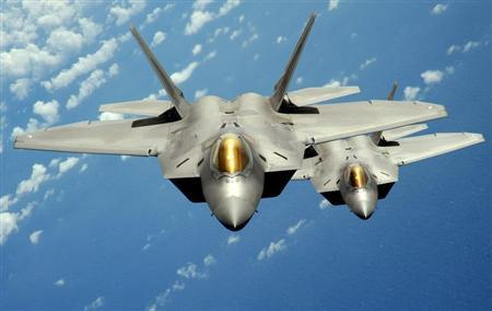 Two U.S. Air Force F-22 Raptor stealth jet fighters fly near Andersen Air Force Base in this handout photo dated August 4, 2010. REUTERS/U.S. Air Force/Master Sgt. Kevin J. Gruenwald/Handout
