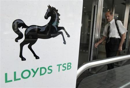 A customer is seen entering a branch of a Lloyds TSB bank in southwest London in this June 30, 2011 file photograph. REUTERS/Luke MacGregor