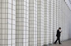 A man walks out from a business building in Tokyo January 24, 2013. REUTERS/Toru Hanai