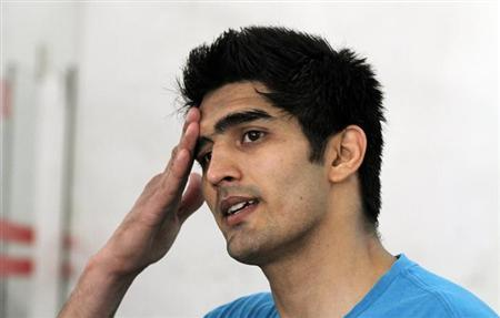Vijender Singh reacts during an interview at Karnail Singh stadium in New Delhi April 2, 2012. REUTERS/Parivartan Sharma/Files