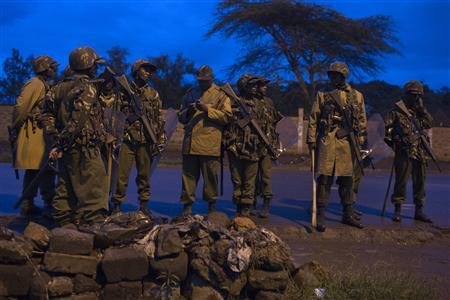 Police officers stand guard during a demonstration in the slum of Mathare, Nairobi March 30, 2013, following the Supreme Court decision of dismissing the case of the opposition party of Raila Odinga who said that the elections on March 4, 2013 were flawed. REUTERS/Siegfried Modola