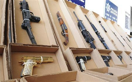 Confiscated weapons are seen at the office of Sonora's State Police in Hermosillo September 7, 2012. REUTERS/Sonora State Police/Handout
