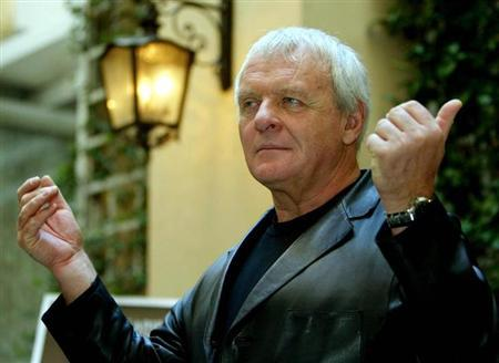 U.S. actor Anthony Hopkins gestures as he arrives for a press conference at a hotel in central Rome October 15, 2002. REUTERS/Paolo Cocco/Files