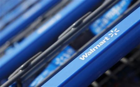 Shopping carts are seen outside a new Walmart Express store in Chicago July 26, 2011. REUTERS/John Gress