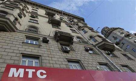A board above an office of mobile phone operator MTS is on display in Moscow, November 14, 2012. REUTERS/Maxim Shemetov