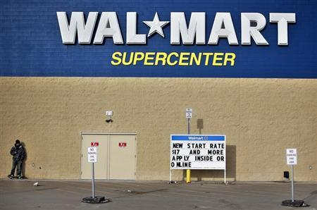 A man stands on a skateboard outside a Wal-Mart store in Williston, North Dakota March 13, 2013. REUTERS/Shannon Stapleton/Files