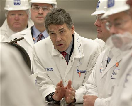 Texas Governor Rick Perry (C) asks a question with Iowa Governor Terry Branstad (R) and Nebraska Lt. Governor Rick Sheehy (2nd R) during a tour of Beef Products Inc.'s plant in South Sioux City, Nebraska March 29, 2012. REUTERS/Nati Harnik/Pool