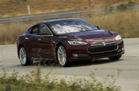 A Tesla Model S electric sedan is driven near the company's factory in Fremont, California, in this file photo taken June 22, 2012. REUTERS/Noah Berger/Files