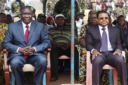 Central African Republic's new President Michel Djotodia (L) sits next to Prime Minister Nicolas Tiangaye at a rally in support of Djotodia in downtown Bangui March 30, 2013. REUTERS/Alain Amontchi
