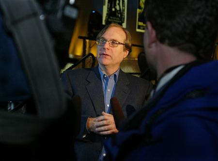 Paul Allen, Microsoft co-founder and the world's fourth richest man according to Forbes Magazine, speaks to the media after he announced plans to build a $20 million science fiction museum adjacent to his Experience Music Project, in Seattle, Washington, April 17, 2003. REUTERS/Anthony P. Bolante