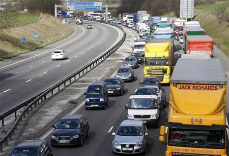 Traffic queues on the M6 motorway near Manchester, northern England March 19, 2012. REUTERS/Phil Noble