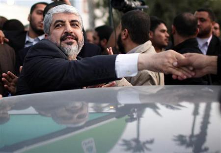 Hamas chief Khaled Meshaal shakes hands with a man as he leaves the Rafah border crossing in the southern Gaza Strip December 10, 2012. REUTERS/Ahmed Jadallah