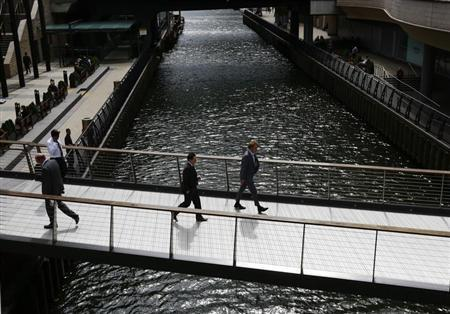 City workers cross a bridge in Canary Wharf, east London August 30, 2012. REUTERS/Olivia Harris