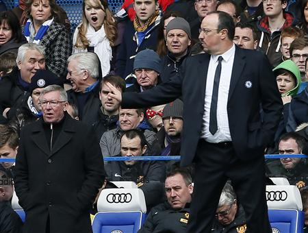 Chelsea's interim manager Rafa Benitez (R) gestures next to Manchester United's manager Alex Ferguson during their English FA Cup quarter-final replay soccer match at Stamford Bridge in London April 1, 2013 REUTERS/Stefan Wermuth