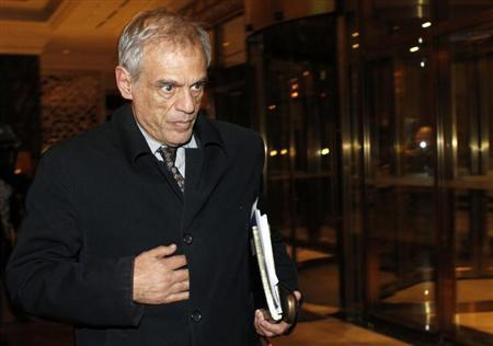 Cyprus's Finance Minister Michael Sarris walks in a hotel lobby after arriving from the Russian Finance Ministry headquarters in Moscow March 21, 2013. REUTERS/Maxim Shemetov