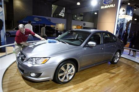 A 2008 Subaru Legacy is polished at the New York International Auto Show in New York April 4, 2007. REUTERS/Keith Bedford