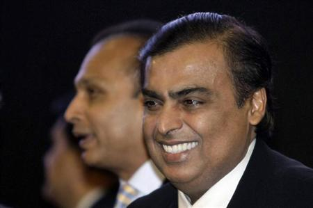 Mukesh Ambani (R), chairman of Reliance Industries, smiles as his brother Anil Ambani, chairman of Reliance Group, stands behind him during the inauguration ceremony of the Vibrant Gujarat global investor summit at Gandhinagar in Gujarat January 11, 2013. REUTERS/Amit Dave/Files