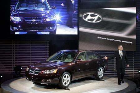 President and CEO of Hyundai America talks about the 2006 Hyundai Sonata at the 2005 North American International Auto Show. REUTERS/Gregory Shamus