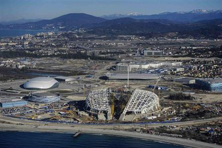 A view from a helicopter shows the Fisht Olympic Stadium (C) and other Olympic venues under construction for the 2014 Winter Olympic games in Sochi March 7, 2013. REUTERS/Nina Zotina/Files