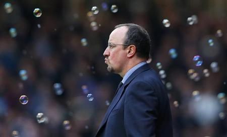 Chelsea's interim manager Rafa Benitez is surrounded by soap bubbles released by West Ham United to celebrate their third goal during their English Premier League soccer match at Upton Park, London December 1, 2012. REUTERS/Andrew Winning/Files