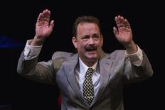 Actor Tom Hanks gestures to the audience after his performance in the premiere of the play Lucky Guy in New York, April 1, 2013. REUTERS/Lucas Jackson