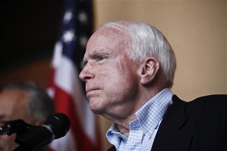 U.S. Senator John McCain (R-AZ) answers questions during a news conference following their tour of the Arizona-Mexico border in Nogales, Arizona March 27, 2013. REUTERS/Samantha Sais