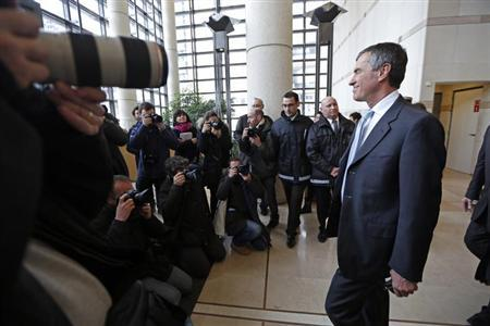 Former French Junior Minister for Budget Jerome Cahuzac (R) is surrounded by photographers as he leaves after a handover ceremony with his successor at the Finance Ministry in Paris March 20, 2013. REUTERS/Charles Platiau