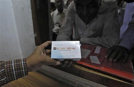 A man buys cancer drug Glivec for a relative who is suffering from cancer at a pharmacy in a government-run hospital in the western Indian city of Ahmedabad April 2, 2013. REUTERS/Amit Dave