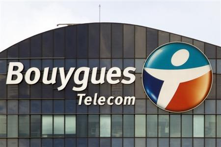A Bouygues Telecom company logo is seen on the facade of the Sequana tower, the company's headquarters, in Issy-Les-Moulineaux, near Paris, August 29, 2012. REUTERS/Charles Platiau