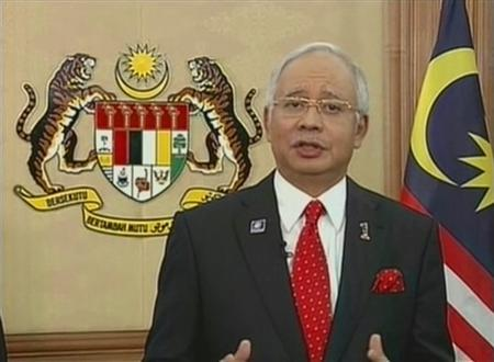 Malaysian Prime Minister Najib Razak speaks to dissolve parliament, paving the way for a long-anticipated general election, in this still image taken from video shot for a live television address, at the administrative capital Putrajaya, near Kuala Lumpur, April 3, 2013. REUTERS/RTM via Reuters TV