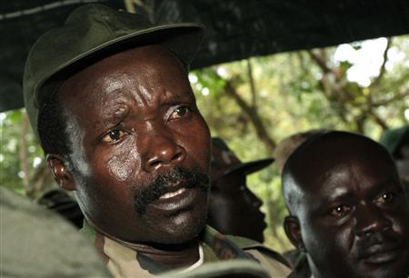 Leader of the Lord's Resistance Army Joseph Kony (L) speaks to journalists after a meeting with U.N. humanitarian chief Jan Egeland (unseen) at Ri-Kwamba in southern Sudan in this November 12, 2006 file photograph. REUTERS/Stuart Price/Pool