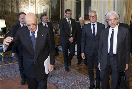 Italian President Giorgio Napolitano (front, L) meets the ''wise men'', a panel of experts he appointed to help find a way out of the political deadlock created by last month's election, at the Quirinale Palace in Rome, in this picture provided by the Italian Presidency Press Office April 2, 2013. REUTERS/Italian Presidency Press Office/Handout