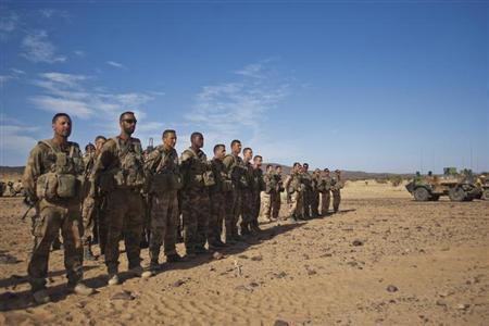 French soldiers stand in formation during a patrol in the Tigharghar valley, about 100 km (62 miles) south of the town of Tessalit in northern Mali March 23, 2013. REUTERS/Francois Rihouay